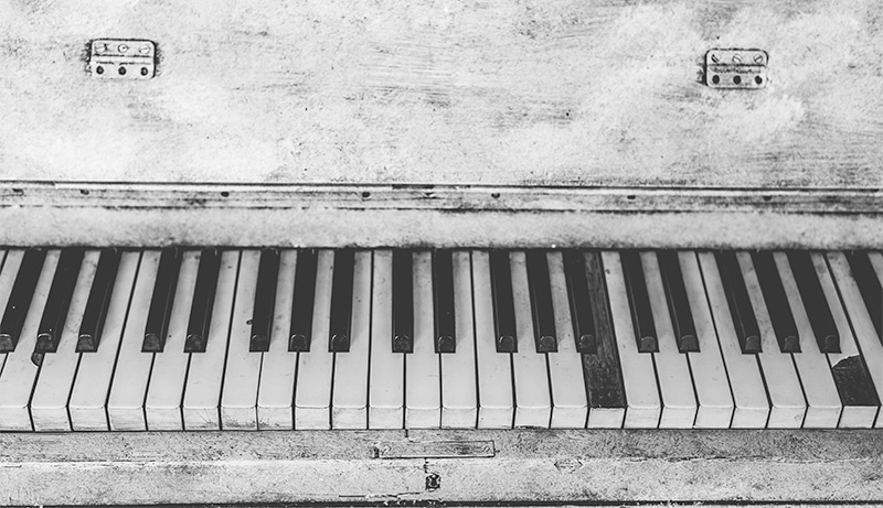 image: tatty old piano